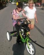 caregiving assistance on rifton bike